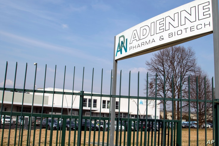 FILE - Signage is seen at the plant of Italian-Swiss pharmaceutical company Adienne Pharma & Biotech, in Caponago, near Milan, Italy, March 9, 2021. Russia signed a deal with the company to produce millions of doses of its Sputnik vaccine this year.