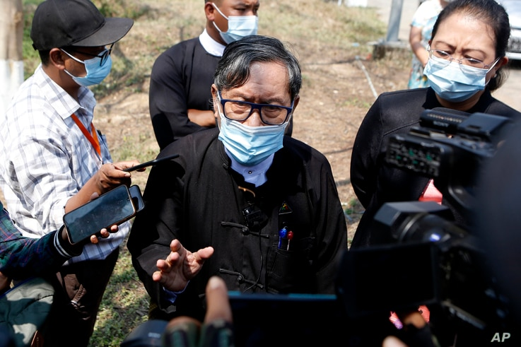 FILE - Khin Maung Zaw, center, a lawyer assigned by the National League for Democracy party to represent deposed Myanmar leader Aung San Suu Kyi, speaks to journalists outside the Zabuthiri Township Court in Naypyitaw, Myanmar, March 1, 2021.