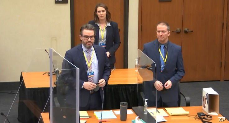 In this image taken from video, defense attorney Eric Nelson, L, defendant former Minneapolis police officer Derek Chauvin, R, are seen during jury selection at the Hennepin County Courthouse in Minneapolis, March 22, 2021.