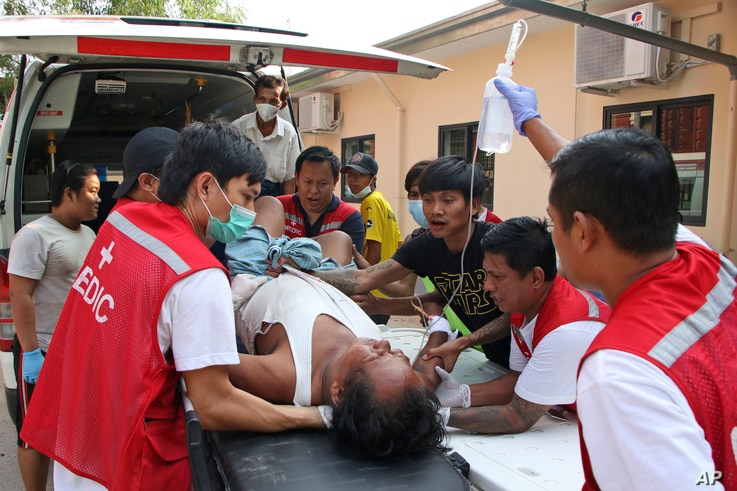An injured anti-coup protester is brought to a hospital for medical treatment, in Yangon, Myanmar, March 27, 2021.
