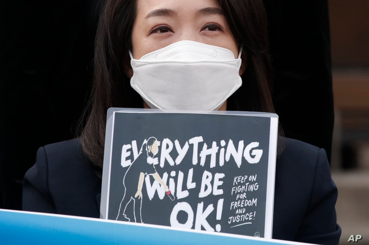 A South Korean lawmaker Choi Hye Young holds a sign during a news conference supporting Myanmar's democracy in front of the Myanmar Embassy in Seoul.