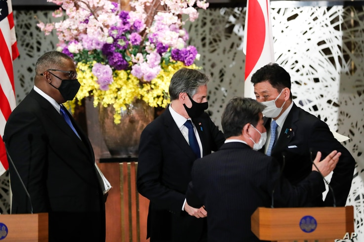 U.S. Secretary of State Antony Blinken (C-L) and Defense Secretary Lloyd Austin (L) leave a joint news conference with Japan's Foreign Minister Toshimitsu Motegi, (C-R), and Defense Minister Nobuo Kishi after their meeting in Tokyo, Japan, March 16, 2021.