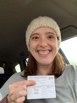 Molly Schuman holds her vaccination card. (Photo: courtesy Molly Schuman)