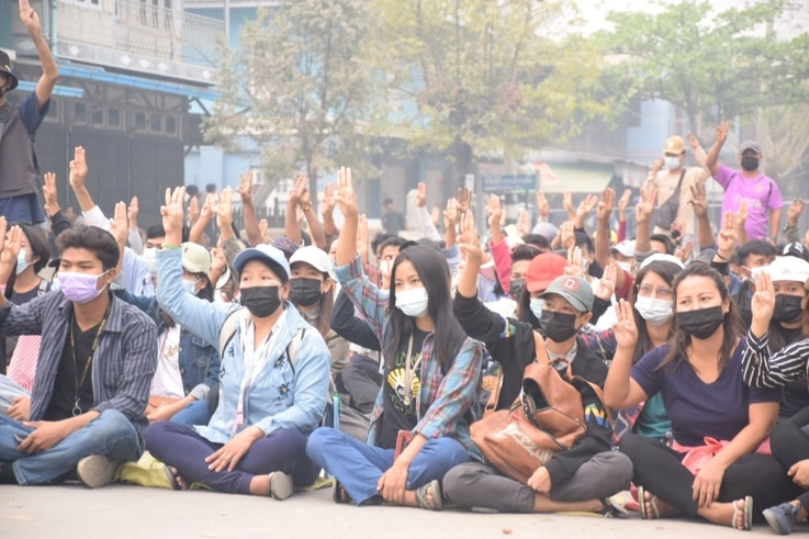 Anti-coup protesters flash the three-finger salute, a symbol of resistance, during a sit-in in Kalay, Sagaing region, Myanmar, March 30, 2021. (Credit: Citizen journalist via VOA Burmese Service)