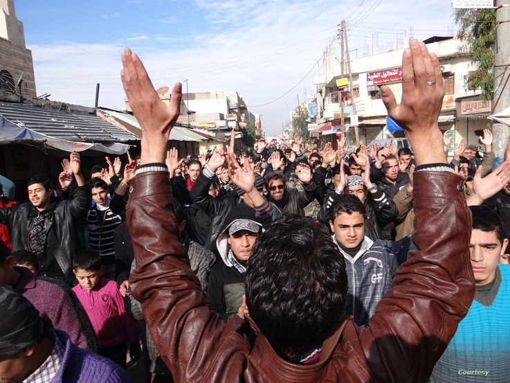 Protesters are seen at an anti-government demonstration in Saraqib, Syria, Dec. 29, 2012. (Courtesy photo)
