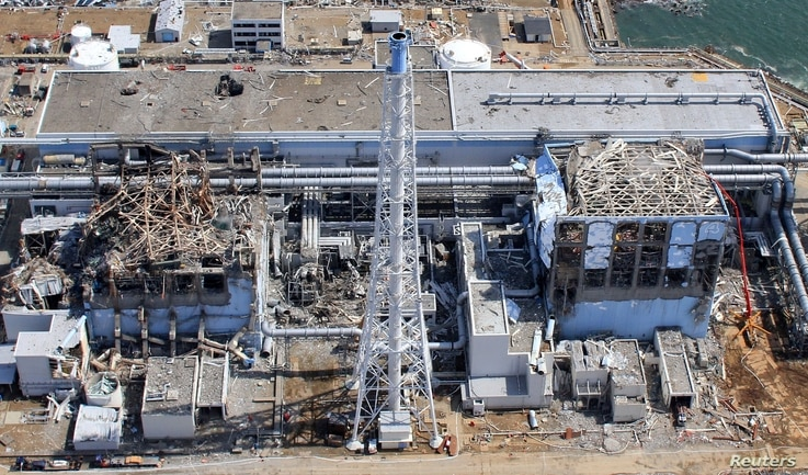 FILE - An aerial view of the damaged Fukushima Daiichi nuclear power plant is seen in Fukushima Prefecture, in this photo taken by Air Photo Service March 24, 2011.