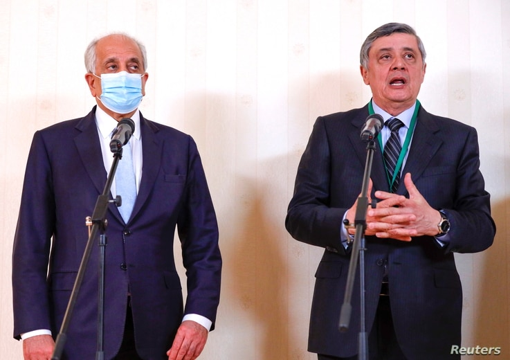 Russia's special representative on Afghanistan Zamir Kabulov, right, and U.S. special envoy Zalmay Khalilzad attend a news briefing following the Afghan peace conference in Moscow, Russia, March 18, 2021.