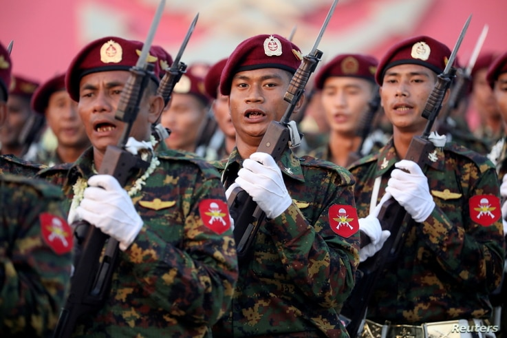 FILE - Soldiers take part in a military parade to mark Armed Forces Day, in the capital Naypyitaw, Myanmar, March 27, 2019.