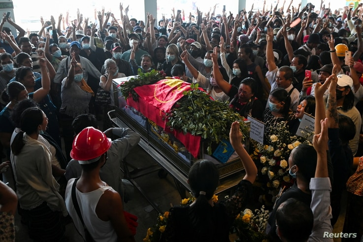 People attend the funeral of a demonstrator shot dead during anti-coup protests, in Yangon, Myanmar, March 5, 2021.