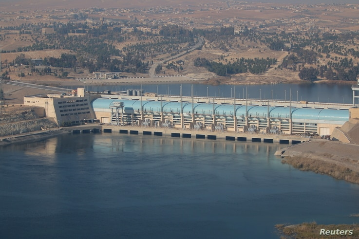 FILE - A general view shows the Tishrin Dam, south of Kobani, Syria, Dec. 27, 2015.