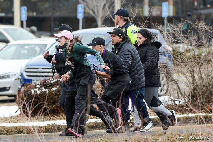 King Soopers employees are led away from an active shooter at the King Soopers grocery store in Boulder, Colorado, March 22. 2021. Police say 10 people were killed in the shooting.