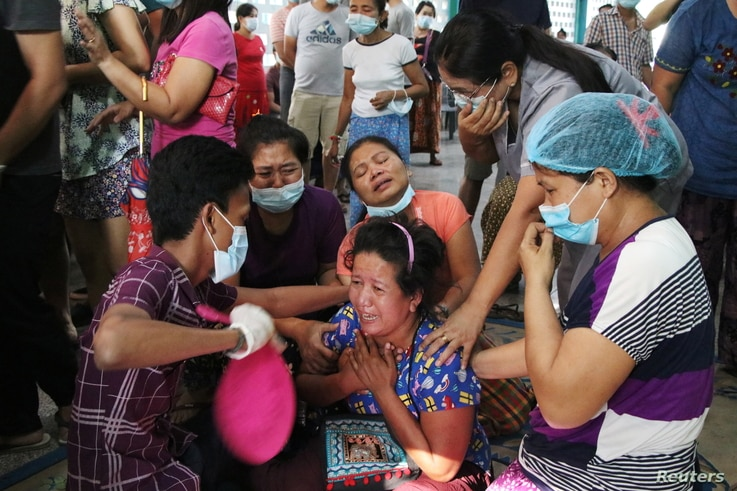 People mourn as they attend the funeral of Thet Paing Soe, who was shot and killed during a protest against the military coup in Yangon, Myanmar, March 20, 2021.