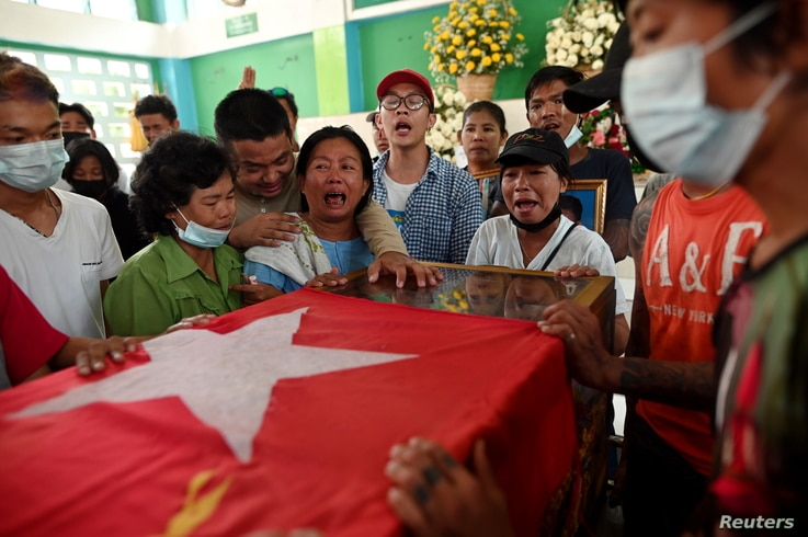 Relatives cry over the body of Min Khant Soe, who was shot and killed during a security force crack down on anti-coup protesters in Yangon, Myanmar, March 15, 2021.
