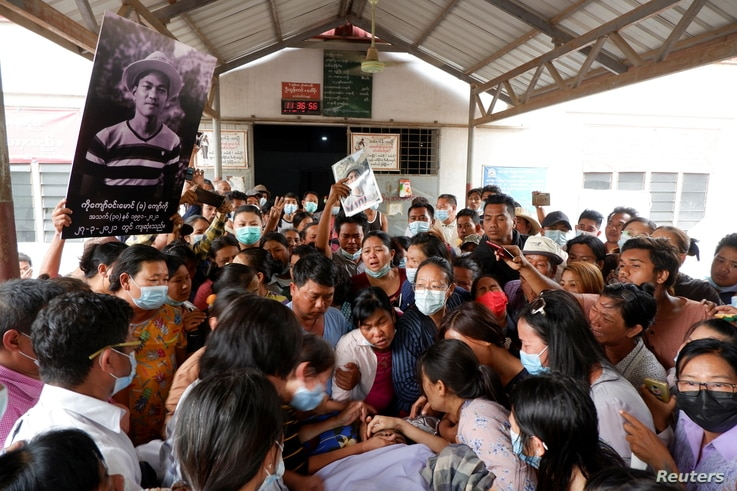 People mourn as they attend the funeral of Kyaw Win Maung, who was shot and killed during a protest against the military coup, in Mandalay, Myanmar, March 28, 2021.