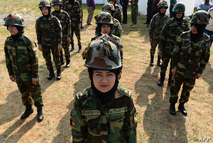 Afghan women army cadets stand in formation during a practice session in Chennai on December 19, 2018. - Nineteen female Afghan...