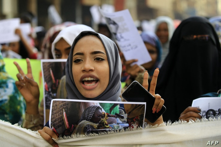 Sudanese from various women's groups take part in a march through the streets of the capital Khartoum to call for the best…