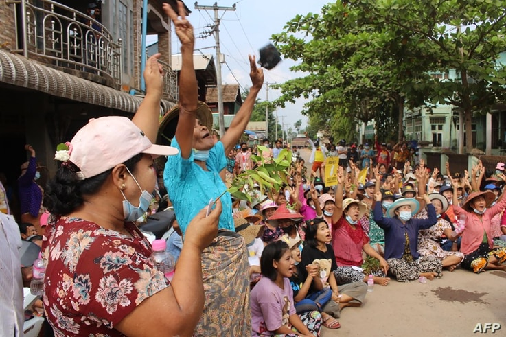 This handout photo taken and released by Dawei Watch on April 1, 2021 shows protesters making the three-finger salute during a…