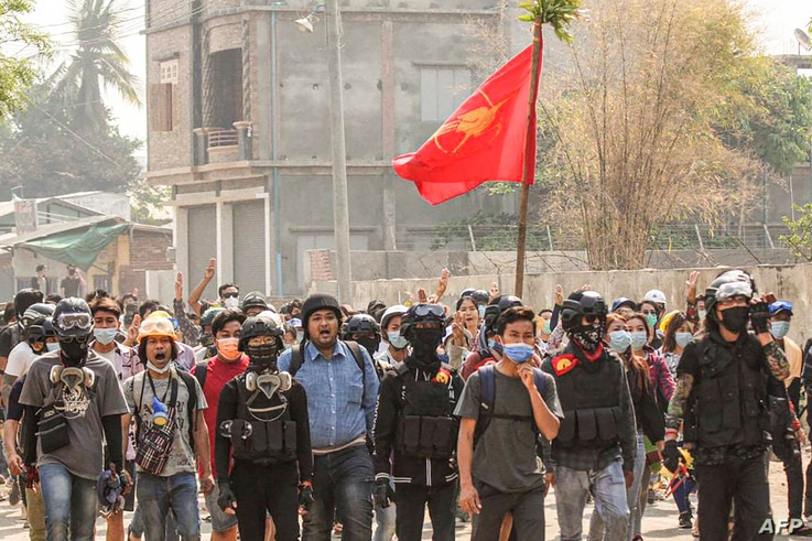 This photo taken and received from an anonymous source via Facebook on April 3, 2021 shows activist Wai Moe Naing (C in blue)…