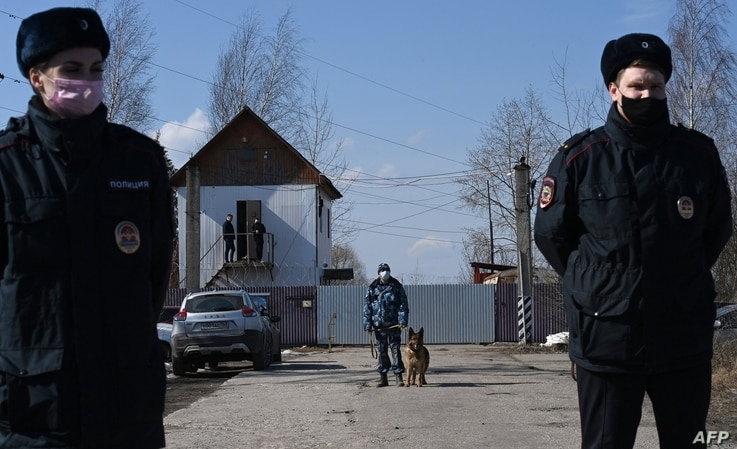 Russian police officers guard the entrance to the penal colony N2, where Kremlin critic Alexei Navalny has been transferred to...