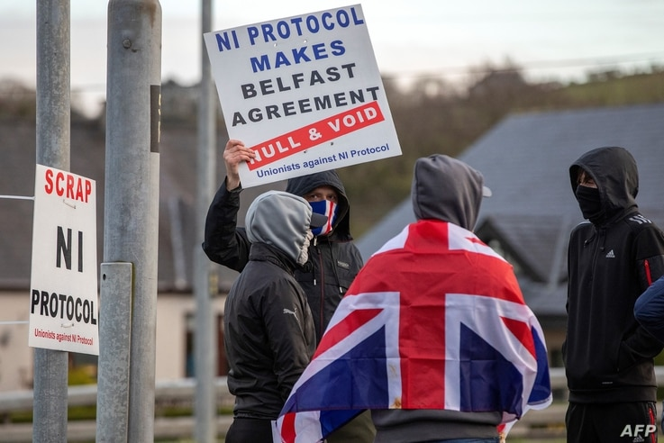 Pro-Union Loyalists demonstrate against the Northern Ireland Protocol implemented following Brexit, on the road leading to the…