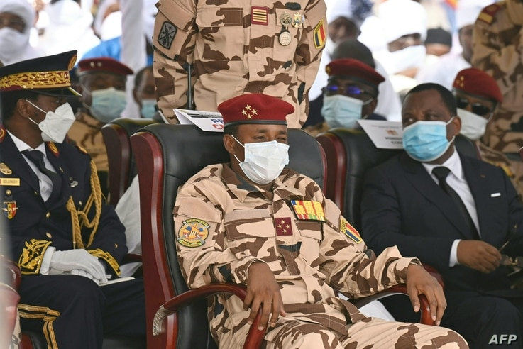 The son of the late Chadian president Idriss Deby, general Mahamat Idriss Deby (R), attend the state funeral for the late…