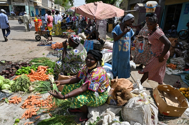 A women sells vegetable in a market in Ndjamena on April 24, 2021, a day after Chad's late president Idriss Deby funeral. -…