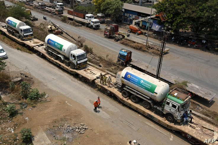 Oxygen tankers are seen on a special train 'Oxygen Express' upon their arrival at a goods yard amid Covid-19 coronavirus…