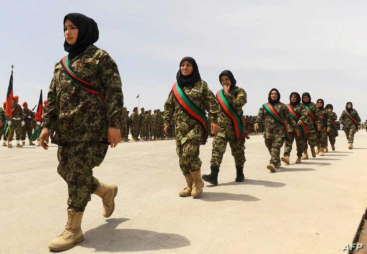Afghan women soldiers march during the 22nd anniversary of the victory of the Afghan Mujahideen, in Herat on April 28, 2014. ...
