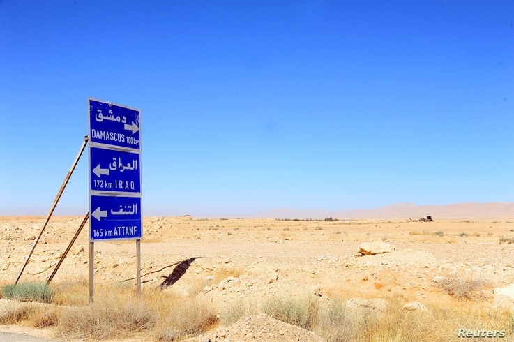 A road sign is pictured in the Badia, in the southeast Syrian desert, in this handout picture provided by SANA on June 13, 2017…