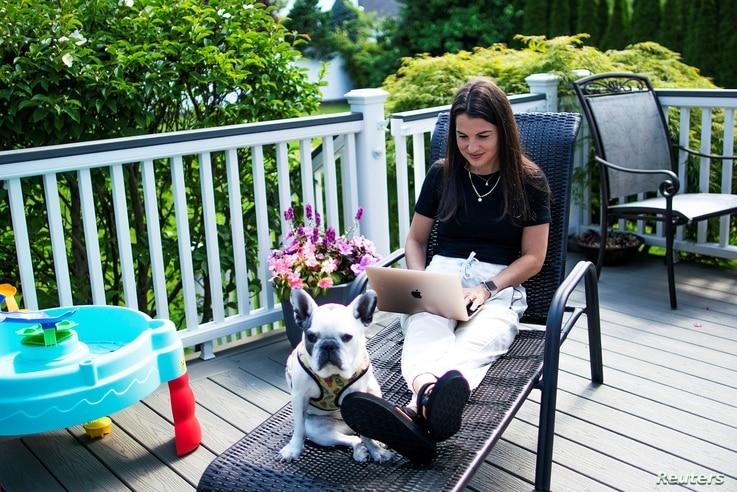 Stephanie Ellis uses her laptop at her home in Marlboro, New Jersey, June 19, 2020.