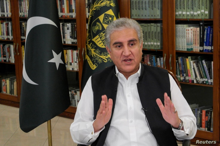 Pakistan's Foreign Minister Shah Mehmood Qureshi gestures as he speaks during an interview with Reuters at the Ministry of…