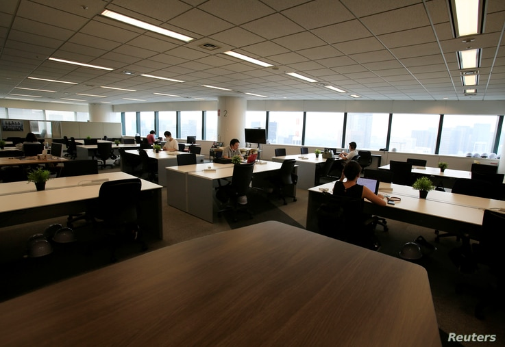 People work in an office where the majority of staff work remotely, amid the coronavirus disease (COVID-19) pandemic in Tokyo, Japan August 7, 2020.