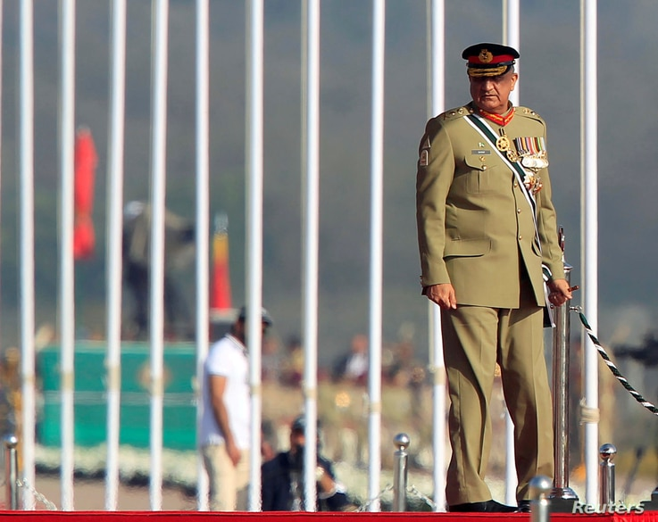 FILE PHOTO: Pakistan's Army Chief of Staff General Qamar Javed Bajwa arrives to attend the Pakistan Day military parade in…