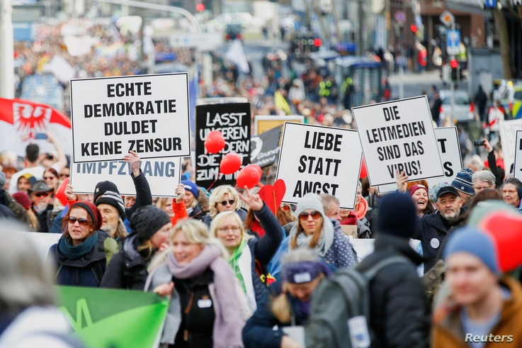 Demonstrators attend a protest against the government's coronavirus disease (COVID-19) restrictions in Kassel, Germany March 20…
