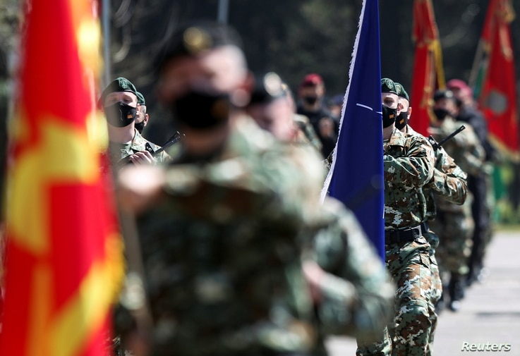 Macedonian Army special forces participate in an exercise attended by U.S. Admiral Robert P. Burke and North Macedonia's...