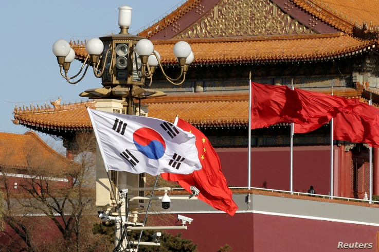FILE PHOTO: South Korea and China's flags flutter next to Tiananmen Gate during the visit of South Korean President Moon Jae-In…