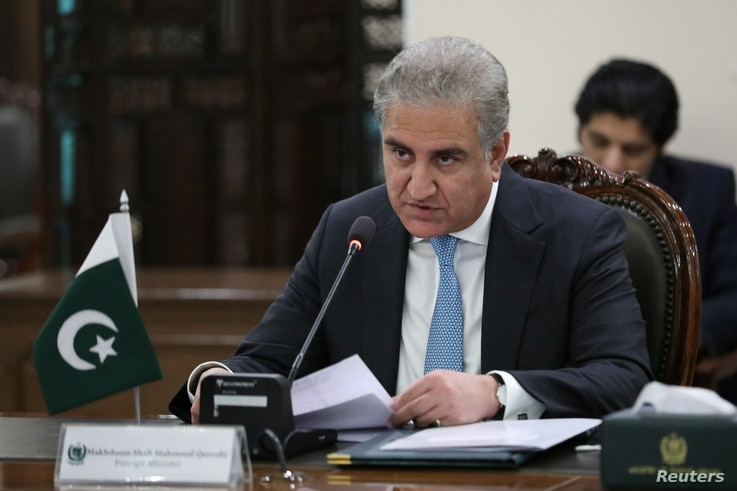 Pakistani Foreign Minister Shah Mehmood Qureshi attends a meeting with his Russian counterpart Sergei Lavrov in Islamabad,...