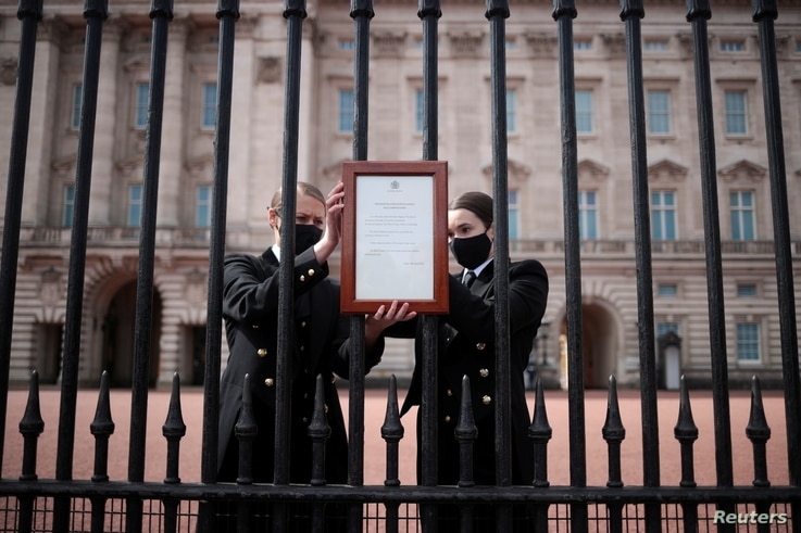 An announcement is attached to the fence of Buckingham Palace after it was announced that Britain's Prince Philip, husband of…