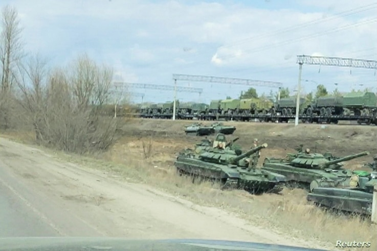 A still image from video shows tanks and military vehicles in Maslovka, Voronezh Region, Russia April 6, 2021. Video taken...
