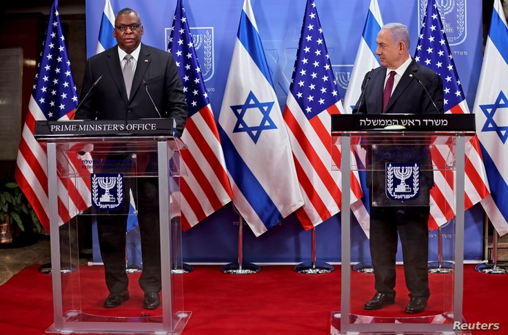 U.S. Defense Secretary Lloyd Austin and Israeli Prime Minister Benjamin Netanyahu give a statement after their meeting.