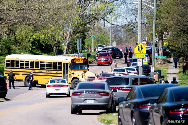 Police attend a shooting at Austin-East Magnet High School in Knoxville, Tennessee, U.S. April 12, 2021. Brianna Paciorka...