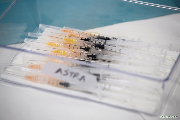 Syringes with AstraZeneca coronavirus disease (COVID-19) vaccines are prepared in Fasano Italy, April 13, 2021. REUTERS...