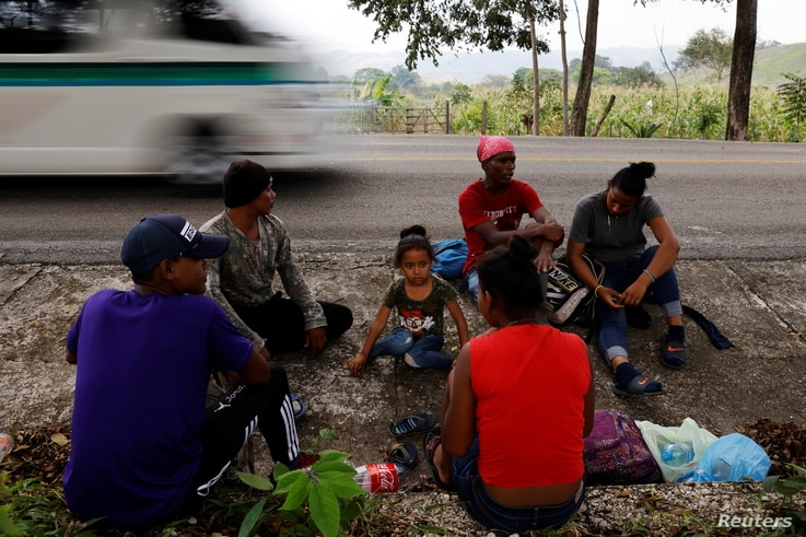 Four-year-old Arony Maude from Honduras rests next to her uncle Edgar Omar, also from Honduras, and the rest of her family…