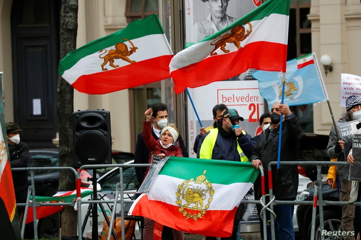 An Iranian opposition group protests outside a hotel, where a meeting of the JCPOA Joint Commission will be held, in Vienna,…