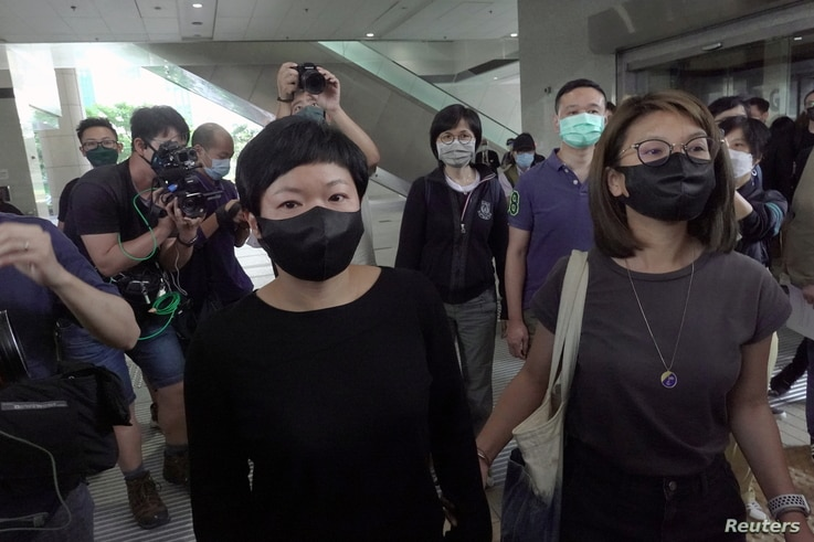 Bao Choy Yuk-Ling, a freelance producer with RTHK, leaves West Kowloon Magistrates' Courts after the court found her guilty of…