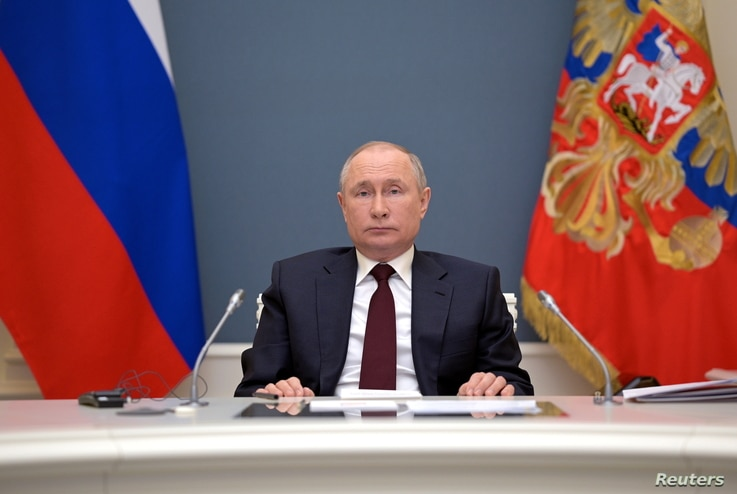 Russian President Vladimir Putin attends a virtual global climate summit via a video link in Moscow, Russia April 22, 2021.