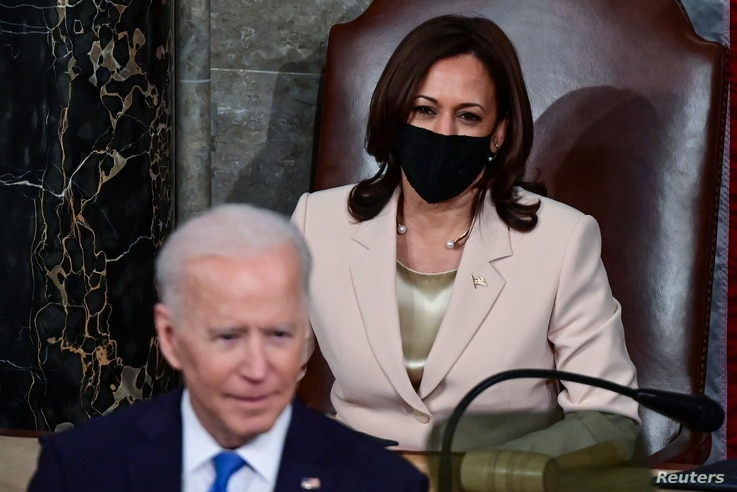 U.S. President Joe Biden addresses a joint session of Congress as U.S. Vice President Kamala Harris looks on at the U.S…