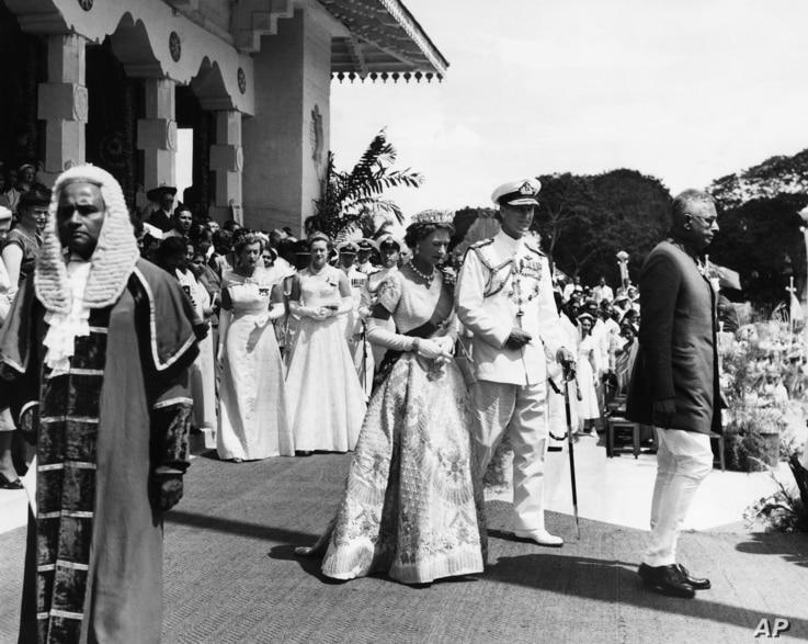 FILE - In this April 12, 1954 file photo, Britain's Queen Elizabeth II and her husband the Duke of Edinburgh leave Freedom Hall.