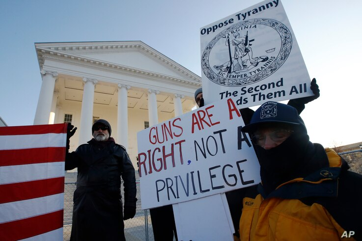 Gun-rights supporters demonstrate in front of state Capitol in Richmond, Va., Monday morning Jan. 20, 2020. Gun-rights…