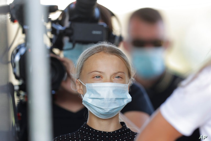 Climate activist Greta Thunberg arrives for a news conference following a meeting with German Chancellor Angela Merkel in...